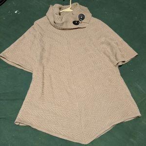 Assymetrical knit short sleeve sweater turtleneck